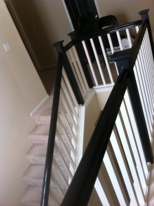 Painted walls, trim, and stained and painted stair rails and posts.